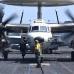 Picture of the Day: Aviation Boatswain's Mate 3rd Class John Gandy Positions an E-2D Hawkeye